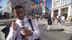 Stock Video Footage of Businessman with smartphone in an area of central London, UK