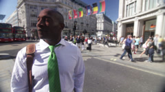 Businessman taking in his surroundings in an area of central London, UK Stock Footage