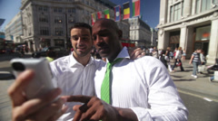 Businessmen with smartphone posing for photo in the city of London, UK Stock Footage