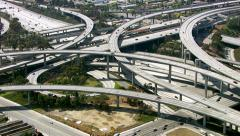 Aerial view of Los Angeles freeway intersection Stock Footage
