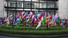Flags of all nations flying outside London building - stock footage
