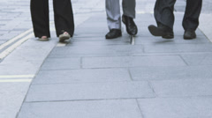 Team of business people walking through city street. Slow motion shot at 100 fps Stock Footage