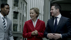 Business people walking in city street. Slow motion shot on RED One Digital Stock Footage