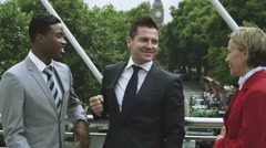 Business people talking outside in London city UK - stock footage