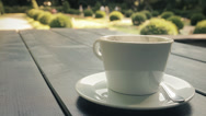 Stock Video Footage of Cup of Coffee on the Garden Table