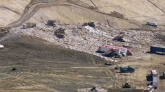 Aerial shot of trucks and tractors working in landfill Stock Footage