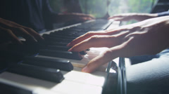 Close up of male hands playing the piano in natural, direct light - stock footage