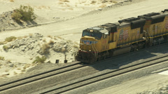 California, USA - March 22, 2012: Aerial shot of train in Mojave Desert Stock Footage