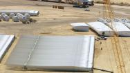 Stock Video Footage of California, USA - March 22, 2012: Aerial shot of wind farm construction site
