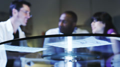 Business team examines financial data - stock footage