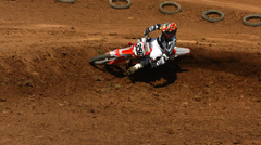 Dirt flies behind motocross racer, super slow motion Stock Footage
