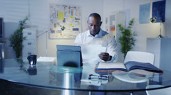 Businessman working all hours. Person still at work during the evening under Stock Footage