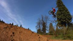 Stock Video Footage of Motocross racer fly over jump, super slow motion