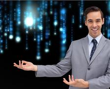 Composite image of young businessman presenting something - stock illustration