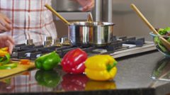 Couple in kitchen together prepare meal, closeup Stock Footage
