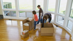 Family having fun in new home - stock footage