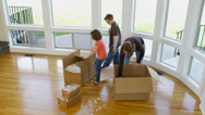 Stock Video Footage of Family having fun in new home