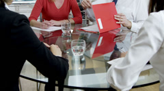 Business teams in boardroom meeting shake hands on a deal Stock Footage
