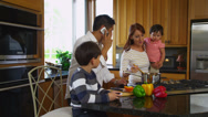 Stock Video Footage of Family in kitchen together, dolly movement