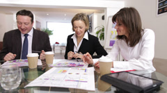 Time lapse of busy business group working together in a meeting - stock footage