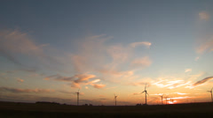 Wind Turbines on Wind Farm Pan across during sunset - stock footage