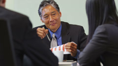 Senior Asian business executive talks at meeting - stock footage