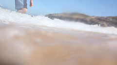 Cute little boy playing in the water at the beach Stock Footage