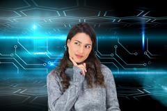 Composite image of pensive model wearing winter clothes holding her tablet Stock Illustration