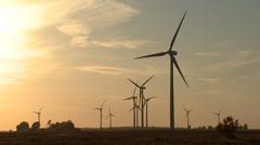 Wind Turbines on Wind Farm at Sunset Wide Shot - stock footage