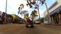 Bike Riding On Balboa Island Main Street- Newport Beach CA Stock Footage