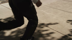 Businessman running through city Stock Footage