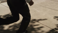 Stock Video Footage of Businessman running through city