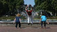 Stock Video Footage of Backflips in front of fountain, slow motion