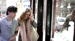 Young couple window shopping in the city of Edinburgh, Scotland Stock Footage