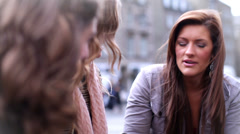 Friends talking out and about in the city. Teenagers in Edinburgh City Scotland. Stock Footage