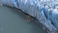 Helicopter flying over glacier, Alaska Stock Footage