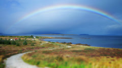 Rainbow over village in Scotland time lapse - stock footage