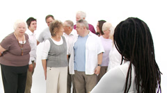 Group of senior people coming together to form a happy close group of - stock footage