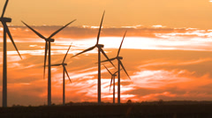 Wind Turbines on Wind Farm with sunset clouds - stock footage