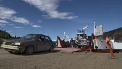 Vehicles Disembarking from Yukon River Ferry Dawson City low angle Stock Footage