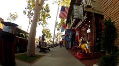 POV Rolling Down Main Street Sidewalk- Balboa Island- Newport Beach CA Stock Footage