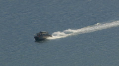 Aerial shot of boat in Alaska strait. Zoom out. - stock footage