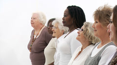 Group of women on white background of various age groups and ethnicity. - stock footage
