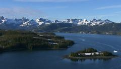 Flying over lake with mountains in background, Alaska - stock footage