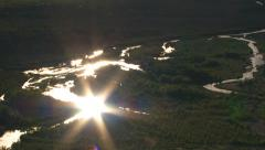 Sun reflects of streams in Alaskan wilderness - stock footage