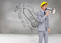 Stock Illustration of Composite image of young architect yelling with a megaphone