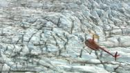 Stock Video Footage of Aerial shot of helicopter and Alaska glacier