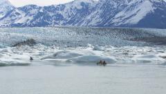 Kayaking by icebergs and glacier, Alaska - stock footage