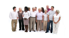 Diverse group of senior people coming together to form a happy close group of Stock Footage