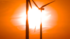 Wind Turbines on Wind Farm during Sunset Close Up Stock Footage